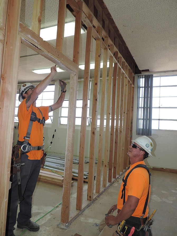 CREW members Dan Matthews and Jake Meistrell renovate classrooms in the west wing of Wy'east Middle School in Odell, one of two major construction projects by Hood River County School District.