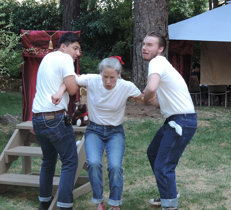 """SNOUT (Alejandro Gamez), left, and Straveling (Nathan Daniel) restrain Snug (Kathleen Morrow) as she stridently takes issue with comments made by yet another thespian fool in this comic scene from """"A Midsummer Night's Dream"""" on the outdoor stage this weekend and next at Stonehedge Gardens. Performances are Aug. 4 and Aug. 10-11, with a buffet dinner at 6 p.m. followed by the show at 7:30 p.m., and Aug. 6, with 4 p.m. dinner and 5:30 p.m. show. Tickets are $50 for adults, $45 for seniors and $40 for students 17 and under. Buy tickets at Waucoma Bookstore and www.showtix4u.com."""
