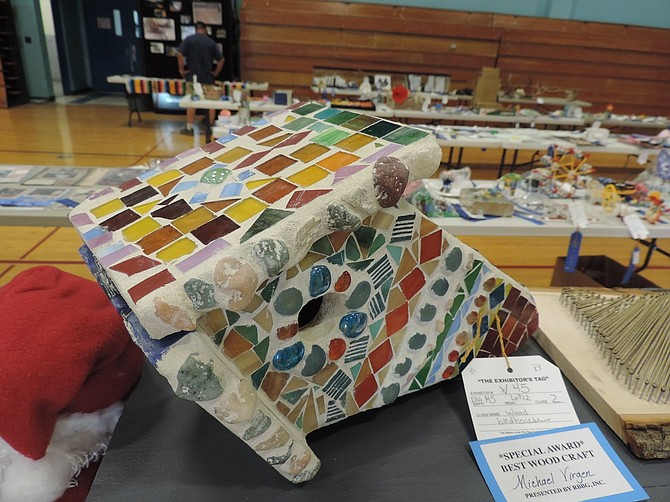 CERAMIC mosaic bird house (18 inches tall) by Michael Virgen won Special Awards for Best Woodcraft item; award sponsored by Hood River Art Club.