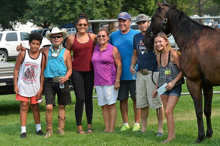The winner's circle following the jackpot Suicide Race on Sunday included, from left, Amari Smith, Montana Pakootas, Mia Smith, Cheryl Pakootas, Joe Pakootas, Loren Marchand, Spade and Shantana Pakootas.