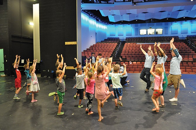 Volunteers lead campers through an exercise at the Little Actors Acting Camp.