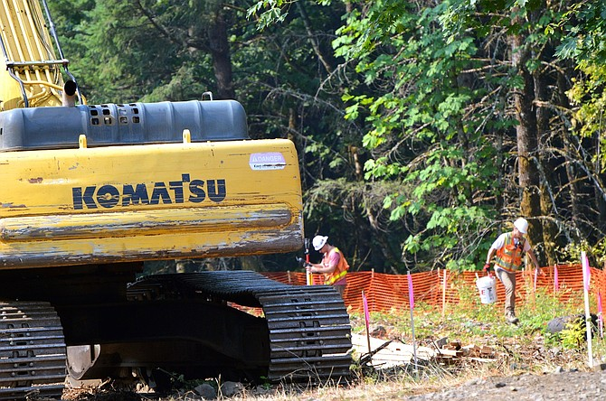CREWS clear brush next to excavation machinery near Wyeth Campground. Transportation agencies are digging into work this summer on a new segment of the Columbia River Historic Highway State Trail, a pedestrian and bike path through the Gorge.
