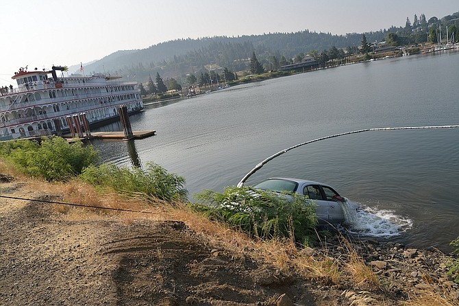 Three adults from the Gorge made it safely out of a car that plunged front end-first into the Hood River Marina Monday afternoon.