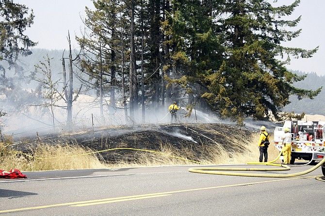 Firefighters fully contained a blaze near the intersection of Kings Valley Highway and Highway 22 on Thursday.