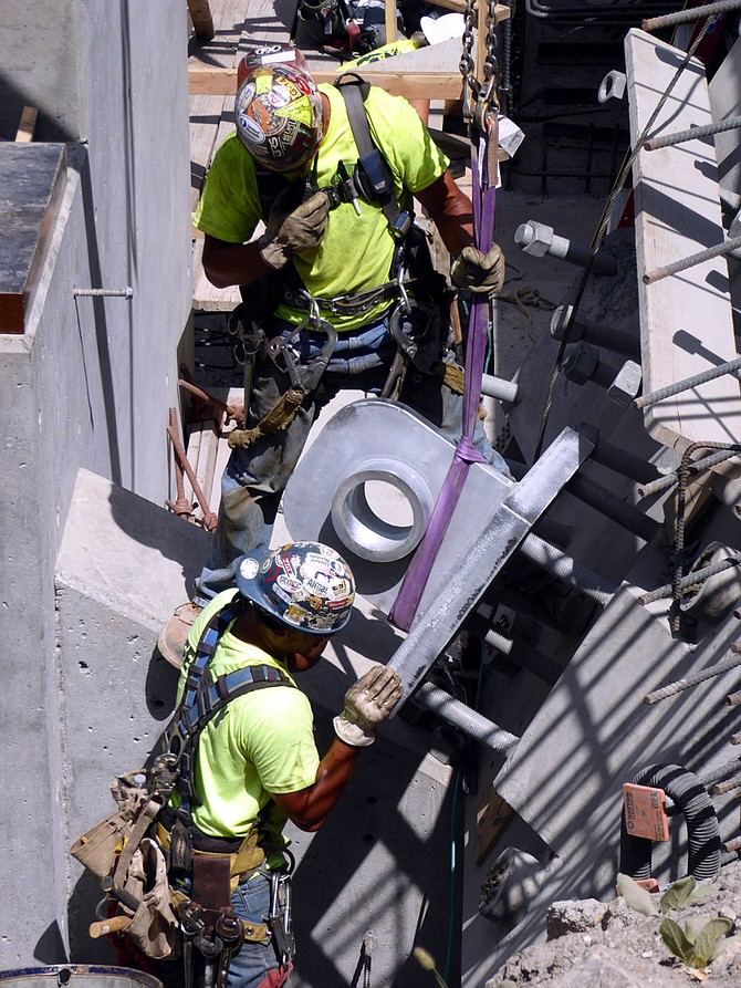 Installation of the new Manning Crevice Bridge main cables last week. Pictured are crews placing the anchor plate for one of the main strand cables.