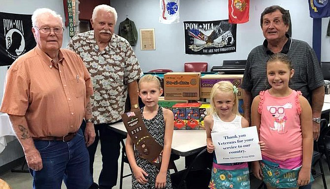 """Girl Scouts troop 3702 in Grangeville delivered """"Troop to Troop"""" cookies to the Idaho County Veterans Center in Grangeville this week. They will also deliver to the Armory. Pictured (L-R) are Earl Barnes, Scott Scribner, Ellie Kouril, Chloe Weisz, Callie Weisz and Ben Paul."""