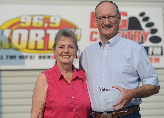 """Jim Church and the local KORT stationreceived the Idaho State Broadcasters Association 2016-2017 """"best sports play-by-play"""" award during an annual gathering of radio and television broadcasters last Saturday, Aug. 5. Pictured with Church is KORT station manager Melinda Hall."""