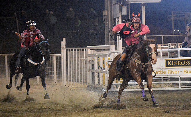 Eagle Boy, with jockey Scott Abrahamson, enters the Stampede Rodeo Arena with a commanding lead over AMP, with jockey Milo Pakootas Jr. at the finish of the World-Famous Suicide Race on Thursday, Aug. 10.
