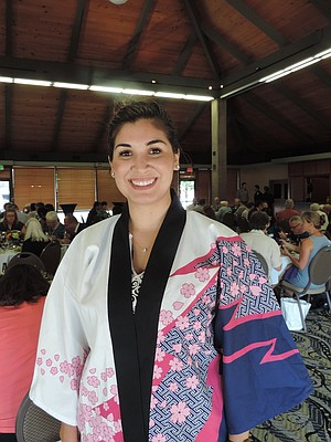 TSURUTA program's new liaison Yesenia Castro, who heads to Japan this weekend, wears a traditional hapi coat during last month's 40th anniversary Sister City dinner.