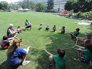 At Mosier Community School, Peace Village participants go through a mini-Ropes Course involving trust-building and other cooperative skills.