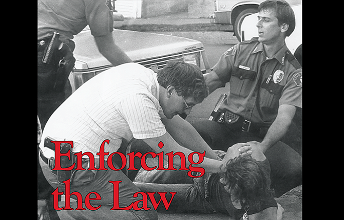 Retired The Dalles Police Capt. Steve Baska is pictured in uniform (at right) helping make an arrest in this award-winning photograph shot for The Dalles Reminder in the 1980s. The picture is featured prominently in the police department.