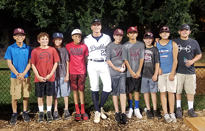 Members of the 12U All Star team from The Dalles enjoyed a night out for a baseball game in Portland last week. From left to right are Diego Gonzalez, Andy Mandy, Trenton Crow, Styles DeLeon, Portland Pickles' pitcher Colton Walker, Riley Brock, Cesar Sanchez, Nolan Donivan, Braden Schwartz, and Peyton Beeks. All-Star teammates who were not at the game included Nathan Hedges, Manatu Crichton-Tunai, Mason Caldwell and Kade Wilson.