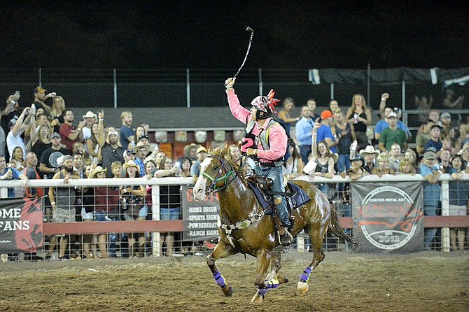 Jockey Scott Abrahamson celebrates a third-straight victory on Eagle Boy in this year's World-Famous Suicide Race on Saturday night. The victory sealed the overall title for Eagle Boy, and its third straight Suicide Race crown.