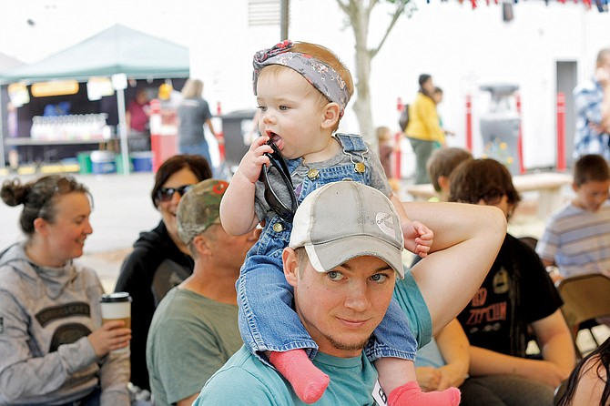 Brylie Emigh, 8 months, sits atop her dad, Matt Emigh, before the 2017 Polk County Fair's Beautiful Baby Contest, a highlight during the three-day run. Brylie followed in her father's footsteps, placing in a category in the contest just like he did in the 1990 contest.