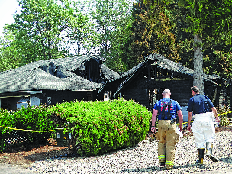 Polk County Fire District No. 1 Deputy Chief Neal Olson helps determine the cause of the home fire on Aug. 9.