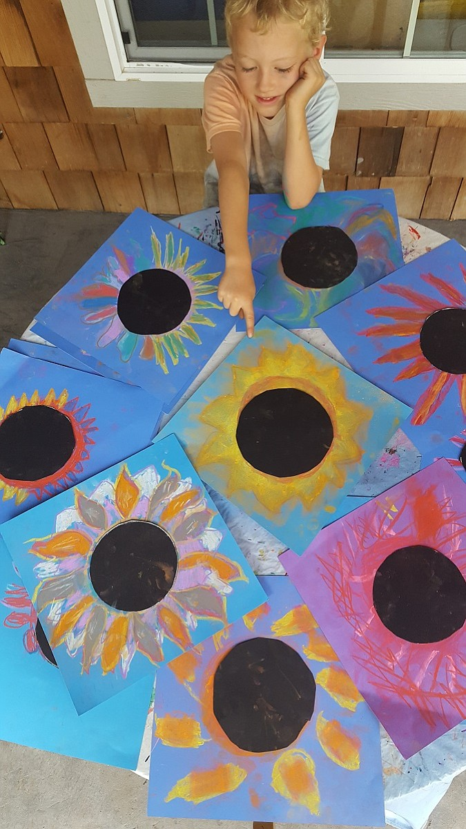 Ollie Gill, 6, and other kids at Kids Creations Art Camp colored images of the sun with pastels and then cut out a circle of black the same size to place over the sun.