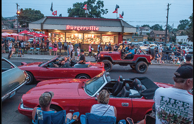 A cluster of red vehicles is seen on Third Street in front of Burgerville, which serves as headquarters for the cruise.