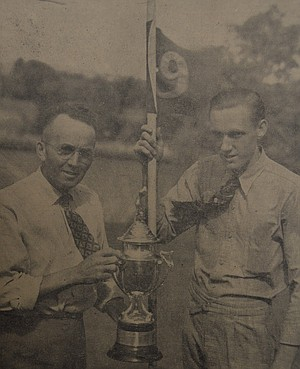 August 13, 1937 — Heber Moore, the gentleman at the left with the wide grin, has a right to smile for last Sunday he won the 1937 Loomis House of Music golf tournament at the Country Club by defeating Bob Morrison, in the final match, 5 and 4. As a result of his victory, Moore will have his name engraved on the Loomis trophy which he is holding above. Morrison, who also upset a number of worth opponents in reaching the finals, is shown at right. HRN Photo-Engraving.