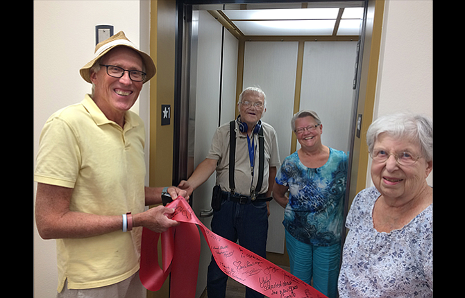 Mid-Columbia Senior Center Executive Director Scott McKay, far left, and Joan Silver, elevator project chair, far right, hosted the opening of the new elevator at the senior center. Inside the elevator are Gary Bradley and Sandy Haechrel, the winners of a raffle to take the first ride.