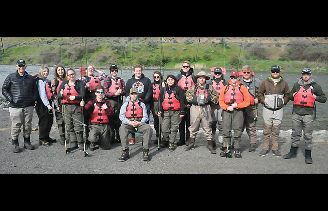 Maupin community members, volunteers and students take part in the South Wasco County High School Fly Fishing class as part of the physical education curriculum. Over the past eight years, students have learned the rules and regulation of the sport. In the photo, from left to right, starting in the back row, Don Jacklin, Jazmin Crowe-Espeland, Ally Muhleman, Madison King, Wilson Wells, Skyler Anderson, Lindsey Hull, Ty Herlocker, Andrew Lindley, Dawson Herlocker, Kris Belozer, and Brandon Wraught. In the front row are, from left, Kayla Brittain, Keith Kegel, Nick Ward, Codi Palmer, Zane Malefyt, and Austin Wustohoff-Gulzow. Belozer, a 2008 SWC graduate, started the fly fishing program as his senior project and has seen the numbers grow over his time involved.