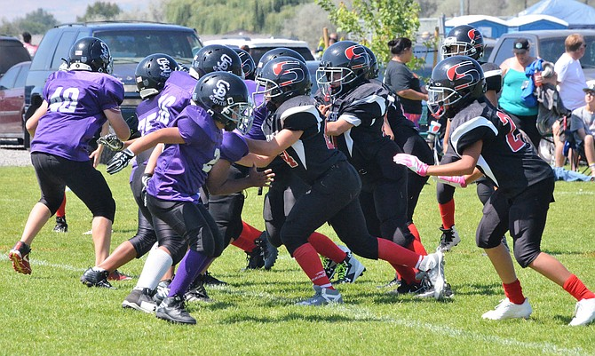 "The Sunnyside ""B"" team in the photo above plays defense against the Saints on Saturday."