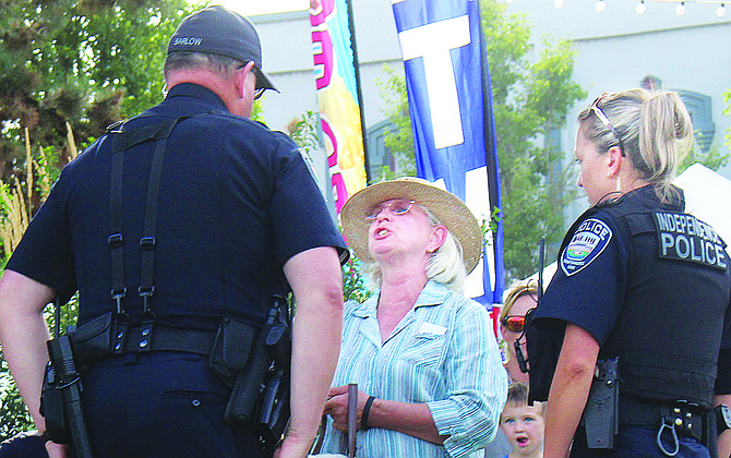 Independence officers assist a woman at the festival.
