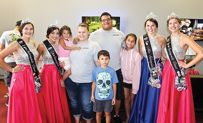 The Miss Sunnyside Court took time to help Amber and Andy Cervantes celebrate the grand opening of Turtle Lounge, 429 South Sixth St. Saturday. Pictured are, from left to right, Princess Allison Palomarez, Samantha Gonzalez, store owners Amber and Andy Cervantes, with their children Emilie, 3, Aiden, 7, and Lucia,11, Miss Sunnyside Molly Marquez and Princess Allison Davis.