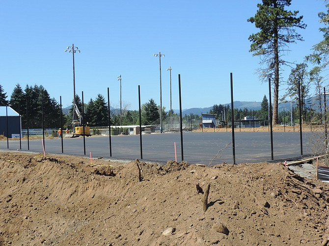 The old picnic shelter is gone and where it stood is the new asphalt base for tennis and pickleball courts and basketball hoops at Golden Eagle Park.