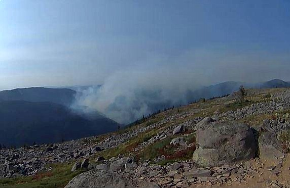 Smoke rises from the Indian Creek Fire.