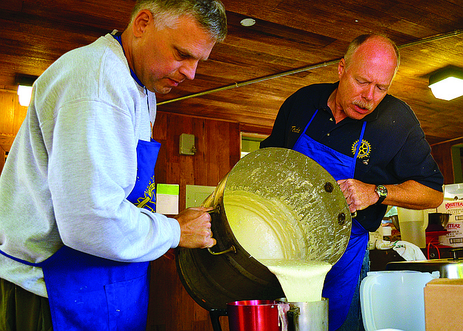 Bob Timmerman, left, and Todd Brumfield prepare pancake batter for Breakfast in the Park in the park's kitchen.