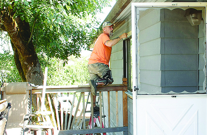 Marv Olson helps complete work on Brandon Doeden's home on Aug. 19.