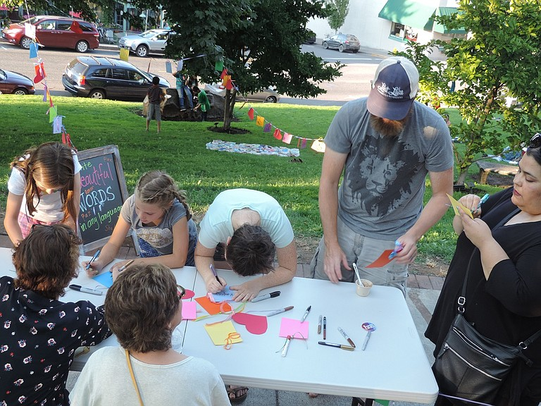"""Gorge Ecumenical Ministries hosted a """"What Do You Want To Cultivate In The World"""" table at Saturday's Unity Picnic at the library."""