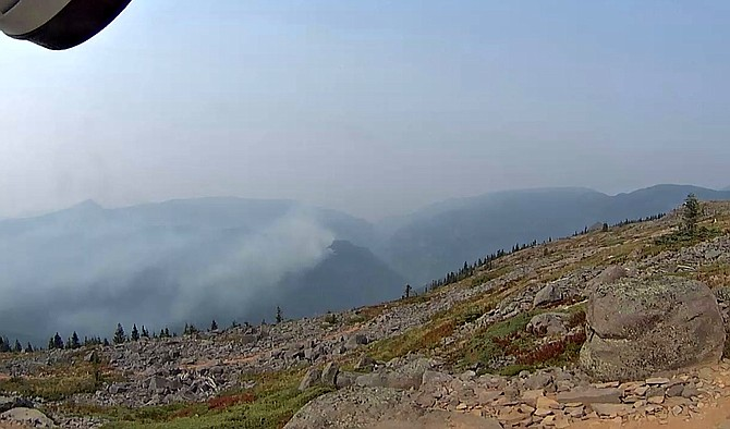 Smoke rises in this monitor photo of the Indian Creek Fire.