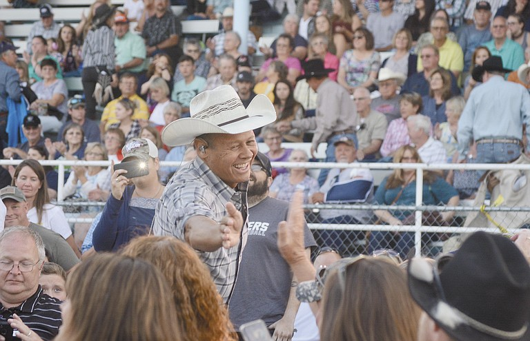 Neal McCoy wanders through the crowd shaking hands during his performance Aug. 25 in Waterville.
