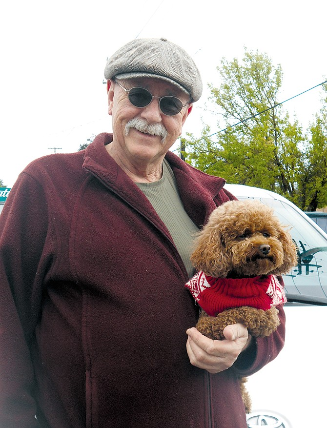 Rod Minarik takes along his mini-poodle MarZ when his passengers are OK with it, but normally she stays at home while he's driving.