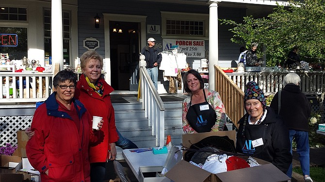 Members of the Assistance League of Salem gathered for the Daue House porch sale. The league runs the consignment shop to help fund its many programs.