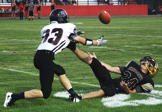 Almira/Coulee-Hartline defensive back Sean Syth tips a pass to Sunnyside Christian running back Kyler Marsh, who still made the catch on the ground.