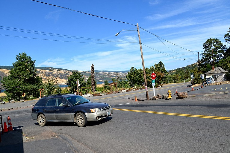 A DRIVER turns right onto Washington Avenue from U.S. Highway 30 in Mosier. City leaders invite people to test out intersection redesigns this weekend in order to give feedback.
