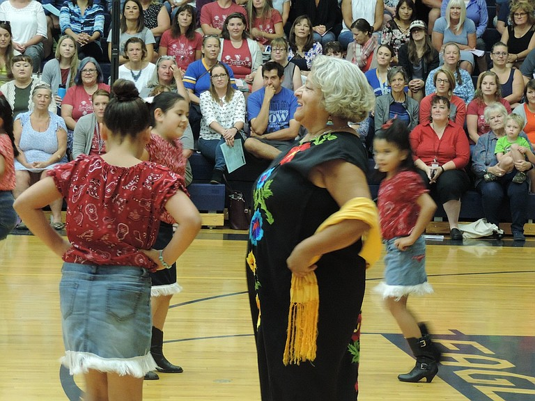 """FOLKLORICO students ranging from kindergarten through middle school showed the skills they learned from Sandy Salazar at Wednesday's staff assembly to kick off the 2017-18 school year, on Ed Vannet Court at Hood River Valley High School. """"Forgive me if I don't quite know the part,"""" Salazar joked as she filled in a dance spot with her third and fourth grade group."""