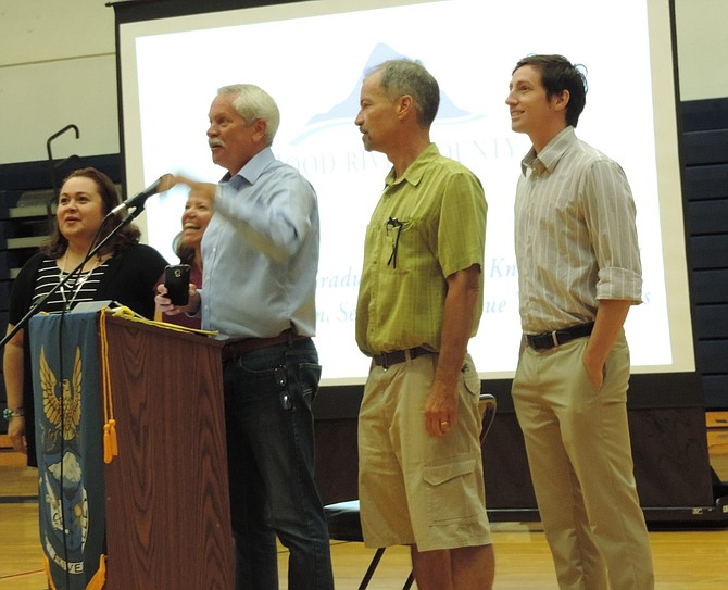 SCHOOL BOARD members greet district staff at Thursday's assembly at HRVHS: from left are Julia Ramirez-Garcia, Chrissy Reitz, chairman Mark Johnson, Rich Truax and Benjamin Sheppard. (Board members Tom Scully and Corinda Hankins-Elliott were not present.)
