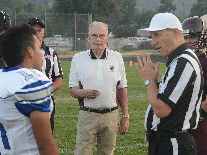 Bob Squires, for whom the Kamiah sports complex was officially named earlier Friday evening, Sept. 1, delivered the pre-game coin toss. Valley called heads and the flip came up tails.