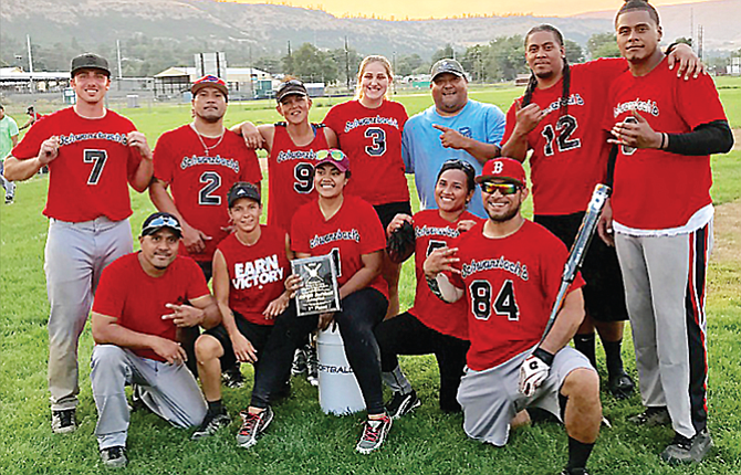 Schwarzbach's Bar players clinched its co-ed softball title after an 18-8 win over Zim's Brau Haus last Sunday at Kramer Field. The players are, pictured from left to right, starting in the back row, Raec Schwarzbach, Fou Siatigi, Alisa Meyer, Amber Tompkins, Tavita Seufalemua, Shaun Tauala, Tamau Tauala. In the front row are, from left, Tuai Siatigi, Kim Kiser, Elisapeta Tunai, Pauline Ofisa-Tauala and Eddy Ofisa. Not pictured are Rebecca Tobias and Jessica Ball.