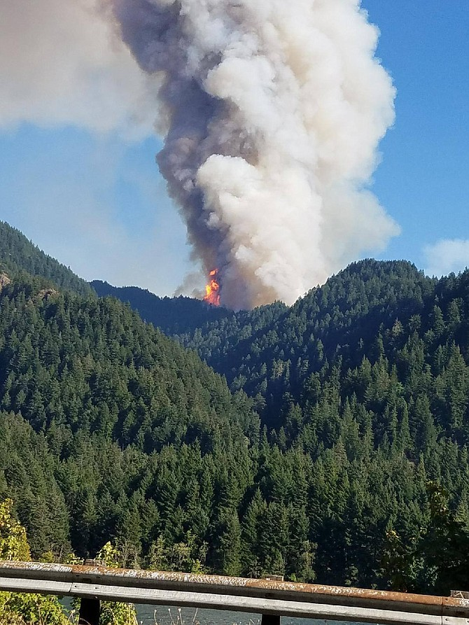 Flames bloom from the Eagle Creek Fire Sunday morning.