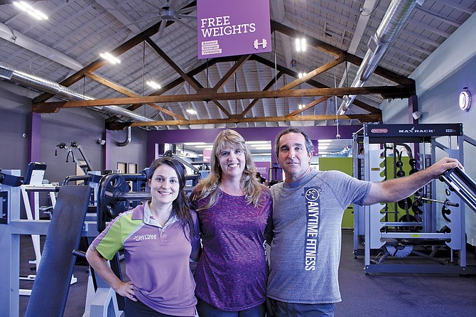 Ari Riecke, left, Anytime Fitness manager, and owners Kelly and Michael Davis recently reopened the downtown gym.