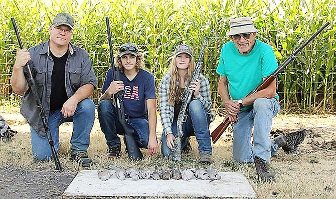 Huston, Amarisah and Olen Osborn, and Lynn Emery pose with the first 10 doves they bagged Friday.