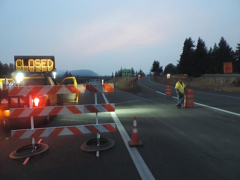 ODOT's Joe Whitesell monitors traffic at Exit 62 on Monday night.