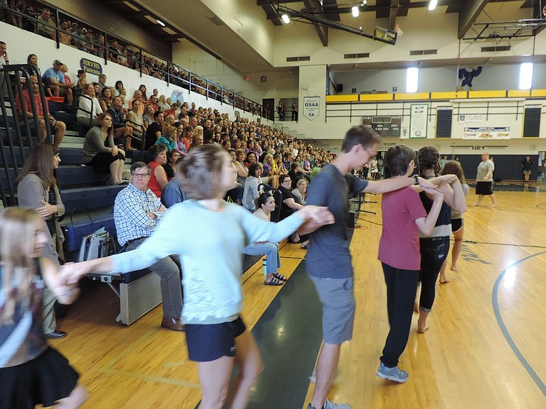 """DISTRICT staff enjoys a performance of songs and dances from the fall HRVHS drama production of """"Fiddler on the Roof,"""" a story of persecution of Jews in czarist Russia. Superintendent Dan Goldman would exhort the staff to 'recognize that humanity and radical anti-racism is our curriculum for every subject.'"""