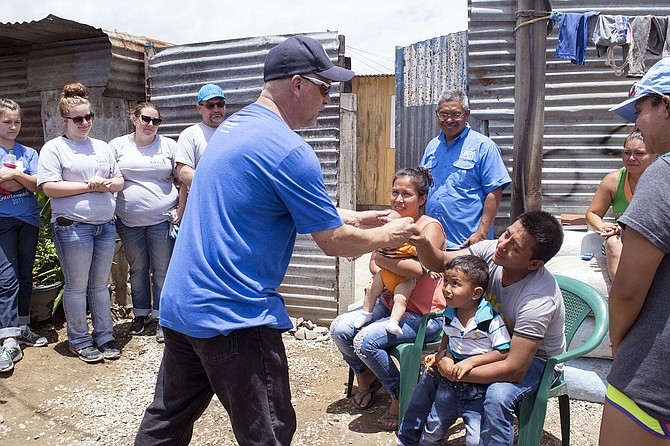 IMMANUEL volunteers worked for a week to bring hope to a village in Guatemala where poverty persists. Above, Pastor Jeff Mueller presents Santiago and Carla with keys to the new home, in an emotional ceremony capping the project.