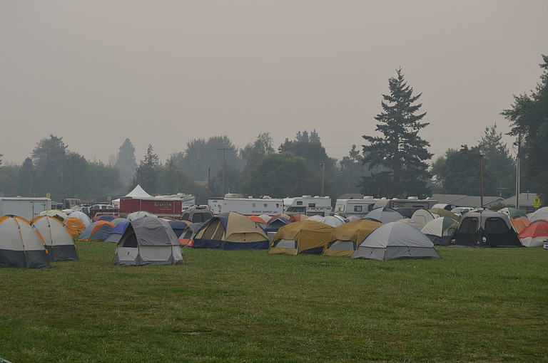 Tents -- and smoke -- fill the Hood River County Fairgrounds Wednesday morning. The grounds are serving as an incident camp for the Eagle Creek Fire.