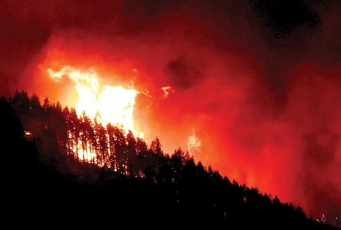Flames reached hundreds of feet into the air Monday night as the Eagle Creek Fire jumped the Columbia River and prompted the closure of Interstate 84, west of Hood River, Ore.